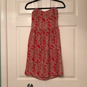 Red and tan strapless dress